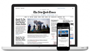 New York Times op laptop en smartphone